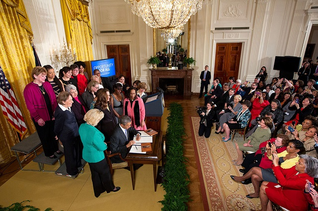 President Barack Obama signs two new executive actions aimed at increasing transparency about women's pay during an event at the White House in Washington, D.C. on April 8, 2014. Photo credit: White House/Chuck Kennedy